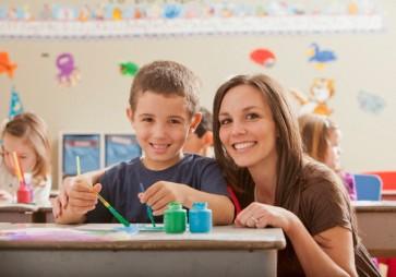 USA, Utah, Orem, Teacher with children (4-5, 6-7) during art classes