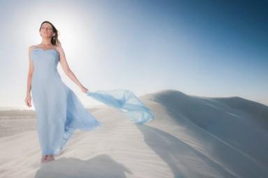 Serene Scene of Woman Stood on Sand Dune